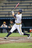 Michigan Wolverines third baseman Jake Bivens (18) follows through on his swing against the Oakland Golden Grizzlies on May 17, 2016 at Ray Fisher Stadium in Ann Arbor, Michigan. Oakland defeated Michigan 6-5 in 10 innings. (Andrew Woolley/Four Seam Images)