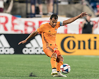 FOXBOROUGH, MA - JUNE 29: Juan Cabezas #5 passes the ball during a game between Houston Dynamo and New England Revolution at Gillette Stadium on June 29, 2019 in Foxborough, Massachusetts.