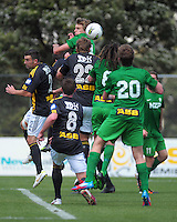 Players go up for a header during the ASB Premiership football match between Team Wellington and Youngheart Manawatu at David Farrington Park, Wellington, New Zealand on Sunday, 25 November 2012. Photo: Dave Lintott / lintottphoto.co.nz.