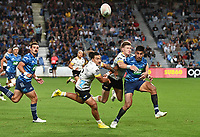 3rd April 2021; Eden Park, Auckland, New Zealand;  Rieko Ioane gets his pass away to Mark Telea for Telea to score a try.<br /> Blues v Hurricanes Super Rugby Aotearoa. Eden Park, Auckland. New Zealand.