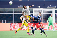 FOXBOROUGH, MA - MAY 16: Waylon Francis #14 Columbus SC leaps for a head ball during a game between Columbus SC and New England Revolution at Gillette Stadium on May 16, 2021 in Foxborough, Massachusetts.