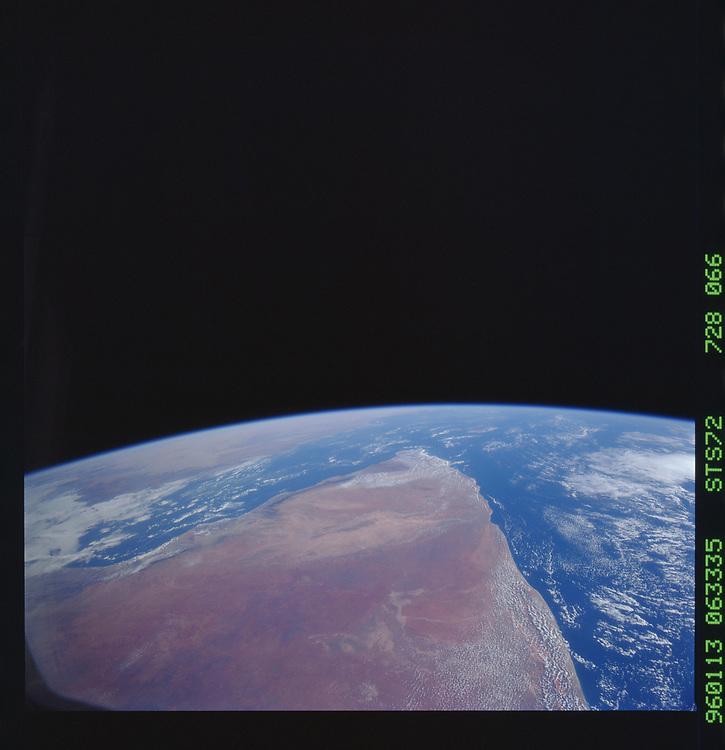 John Angerson. STS-72 Book.<br /> Public Domain Image.<br /> NASA images Courtesy National Archives - Record Group number: 255-STS-STS072<br /> <br /> Description: Earth observations taken from shuttle orbiter Endeavour during STS-72 mission.<br /> <br /> Subject Terms: STS-72, ENDEAVOUR (ORBITER), EARTH OBSERVATIONS (FROM SPACE), EARTH LIMB<br /> <br /> Date Taken: 1/13/1996<br /> <br /> Categories: Earth Observations<br /> <br /> Interior_Exterior: Exterior<br /> <br /> Ground_Orbit: On-orbit<br /> <br /> Original: Film - 70MM CT<br /> <br /> Preservation File Format: TIFF<br /> <br /> geon: SOMALIA<br /> <br /> feat: PAN-COAST, GULF OF ADEN<br /> <br /> tilt: High Oblique<br /> <br /> cldp: 15<br /> <br /> nlat: 2<br /> <br /> nlon: 46.3<br /> <br /> azi: 125<br /> <br /> alt: 246<br /> <br /> elev: 46