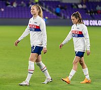 ORLANDO, FL - JANUARY 18: Samantha Mewis #3 and Kelley O'Hara #5 of the USWNT enters the field before a game between Colombia and USWNT at Exploria Stadium on January 18, 2021 in Orlando, Florida.