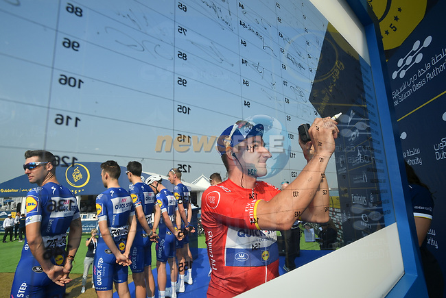 Red Jersey holder Elia Viviani (ITA) Quick-Step Floors at sign on before the start of Stage 3 The Silicon Oasis Stage of the Dubai Tour 2018 the Dubai Tour's 5th edition, running 180km from Skydive Dubai to Fujairah, Dubai, United Arab Emirates. 7th February 2018.<br /> Picture: LaPresse/Massimo Paolone | Cyclefile<br /> <br /> <br /> All photos usage must carry mandatory copyright credit (© Cyclefile | LaPresse/Massimo Paolone)