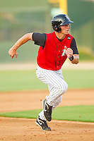 Collin Kuhn #13 of the Kannapolis Intimidators takes off for third base against the Asheville Tourists at Fieldcrest Cannon Stadium on July 28, 2011 in Kannapolis, North Carolina.  The Intimidators defeated the Tourists 2-1 in 10 innings.   (Brian Westerholt / Four Seam Images)