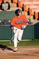 Catcher Adam Hackenberg (17) of the Clemson Tigers bats in a game against the Stony Brook Seawolves on Friday, February 21, 2020, at Doug Kingsmore Stadium in Clemson, South Carolina. Clemson won, 2-0. (Tom Priddy/Four Seam Images)