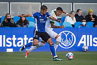 SAN JOSE, CA - MAY 15: Luciano Abecasis #2 of the San Jose Earthquakes challenges Marvin Loria #44 of the Portland Timbers for the ball during a game between San Jose Earthquakes and Portland Timbers at PayPal Park on May 15, 2021 in San Jose, California.