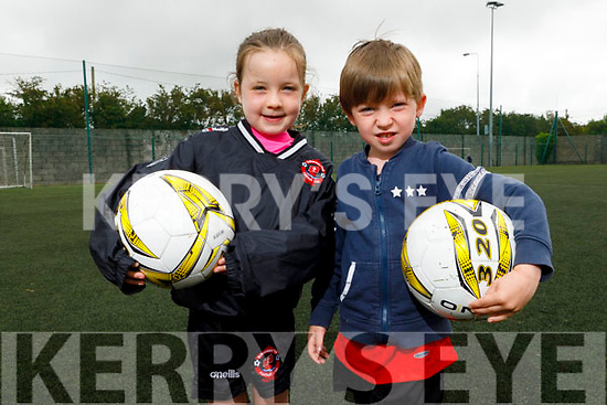 Siún and Ben Foley from Tralee enjoying the Park FC Summer Camp in Christy Leahy Park on Monday.