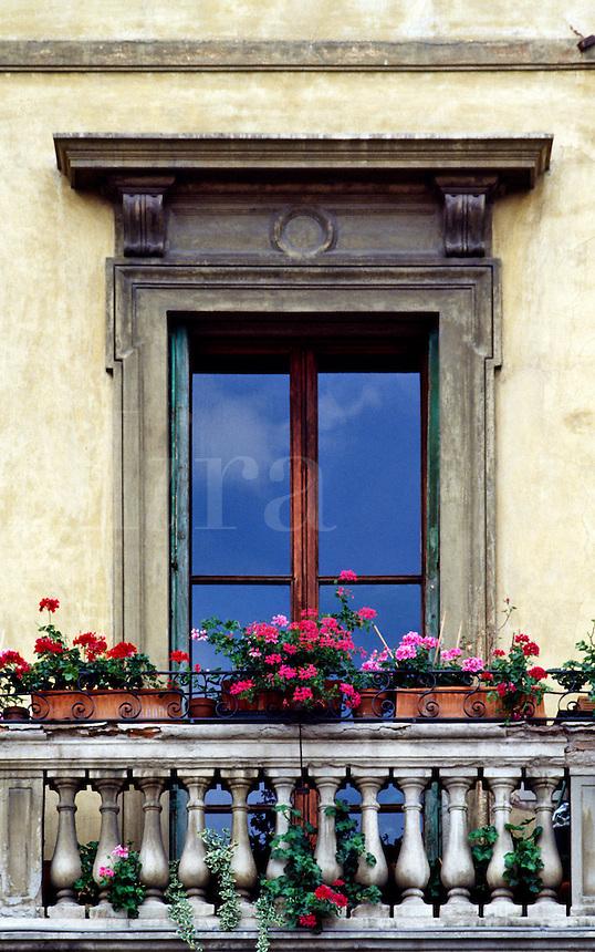 Rustic window, balcony and flowers.