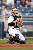 Tulsa Drillers catcher Dustin Garneau (13) during a game against the Midland RockHounds on May 31, 2014 at ONEOK Field in Tulsa, Oklahoma.  Tulsa defeated Midland 5-3.  (Mike Janes/Four Seam Images)
