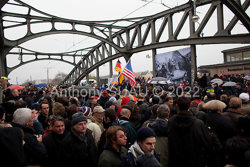 """Berlin, Germany<br /> November 9, 2009<br /> <br /> Crowds look on as Chancellor Angela Merkel and former Soviet leader Mikhail Gorbachev crossed a former fortified border, the Bornholmer bridge, on Monday to cheers of """"Gorby! Gorby!"""" as a throng of grateful Germans recalled the night 20 years ago that the Berlin Wall gave way to their desire for freedom and unity.<br /> <br /> Within hours of a confused announcement on Nov. 9, 1989 that East Germany was lifting travel restrictions, hundreds of people streamed into the enclave that was West Berlin, marking a pivotal moment in the collapse of communism in Europe.<br /> <br /> Merkel, who grew up in East Germany and was one of thousands to cross that night, recalled that """"before the joy of freedom came, many people suffered.""""<br /> <br /> She lauded Gorbachev, with whom she shared an umbrella amid a crush of hundreds, eager for a glimpse of the man many still consider a hero for his role in pushing reform in the Soviet Union."""