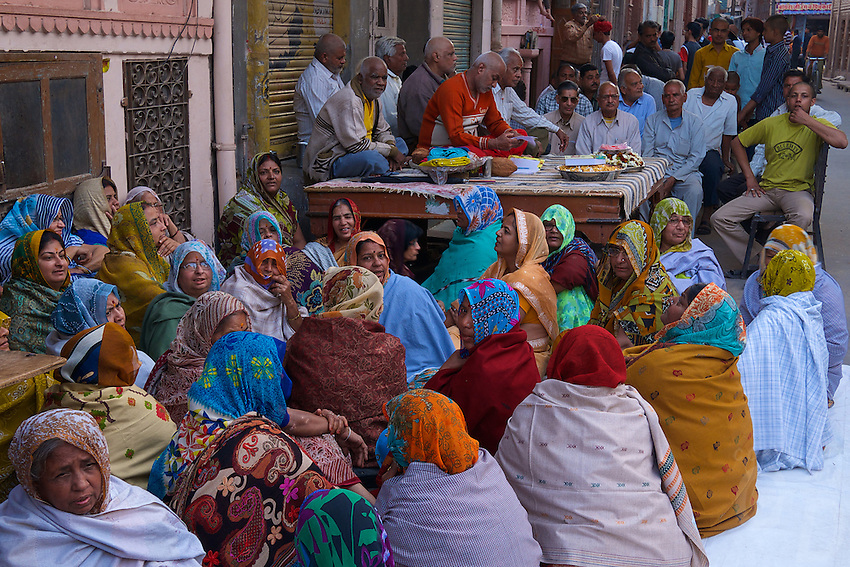 Large gathering of local women in the street, the day before the Holi festival in Bikaner, Rajasthan, India