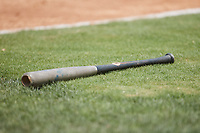A broken bat lies in the grass near home plate during the game between the Bowie Baysox and the Richmond Flying Squirrels at The Diamond on July 28, 2021, in Richmond Virginia. (Brian Westerholt/Four Seam Images)