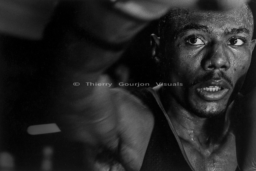 """Super Bantamweight  Agapito """"El Ciclón"""" Sánchez (1970 -2005) shadow boxing in the ring at Gleason's Gym, Brooklyn, New York. Photo by Thierry Gourjon-Bieltvedt. 1995."""