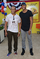 Ray Parker Jr. + son @ the premiere of 'Sausage Party' held @ the Regency Village theatre.<br /> August 9, 2016