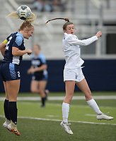 Rogers' Allison Golden (right) sends the ball Tuesday, April 27, 2021, past Springdale Har-Ber's Natalie Bartlett (left) during the first half of play at Wildcat Stadium in Springdale. Visit nwaonline.com/210428Daily/ for today's photo gallery. <br /> (NWA Democrat-Gazette/Andy Shupe)