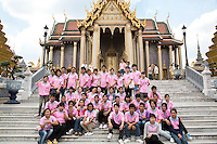 Thailand. Bangkok. Grand Palace. A group of students, wearing a pink t-shirt, pose for a group portrait in front of the Royal Monastery of the Emerald Buddha. One of the most venerated sites where people convene to pay respect to the Lord Buddha and His teachings. The Grand Palace was established in 1782 and it houses not only the royal residence but also a number of government offices. Tha Thian is surrounded by a major heritage and tourist site, The Grand Palace. Tha Tian's community is located in the downtown area and in the center of the urban historic district, called Koh Rattanakosin. 02.04.09  © 2009 Didier Ruef