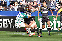 Sunday 19 October 2014<br /> Pictured: Ospreys second row Alun Wyn-Jones gets tackled by Treviso wing Angelo Esposito.<br /> Re: Ospreys v Treviso, Heineken Champions Cup at the Liberty Stadium, Swansea