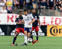 FOXBOROUGH, MA - AUGUST 18: Drew Skundrich #12 of D.C. United passes the ball as Maciel #13 of New England Revolution defends during a game between D.C. United and New England Revolution at Gillette Stadium on August 18, 2021 in Foxborough, Massachusetts.