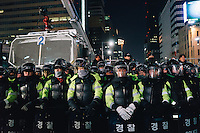 Dec, 2013 - Police forces in riot gear block and confront the striking Korea Railway workers in Seoul.