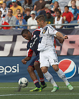 New England Revolution defender Andrew Farrell (2) works hard to intercept pass to LA Galaxy substitute midfielder Robbie Rogers (14). In a Major League Soccer (MLS) match, the New England Revolution (blue) defeated LA Galaxy (white), 5-0, at Gillette Stadium on June 2, 2013.