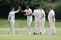 M Irfan of Hornchurch celebrates with his team mates after taking the wicket of M Bell during Billericay CC (batting) vs Hornchurch CC, Hamro Foundation Essex League Cricket at the Toby Howe Cricket Ground on 12th June 2021