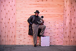 Photographer Louis Mendes stands in front of a boarded up business in Times Square as people gather in celebration after former Vice President Joe Biden was declared the winner of the 2020 presidential election between U.S. President Donald Trump and Biden on November 7, 2020 in New York City.  Photograph by Michael Nagle