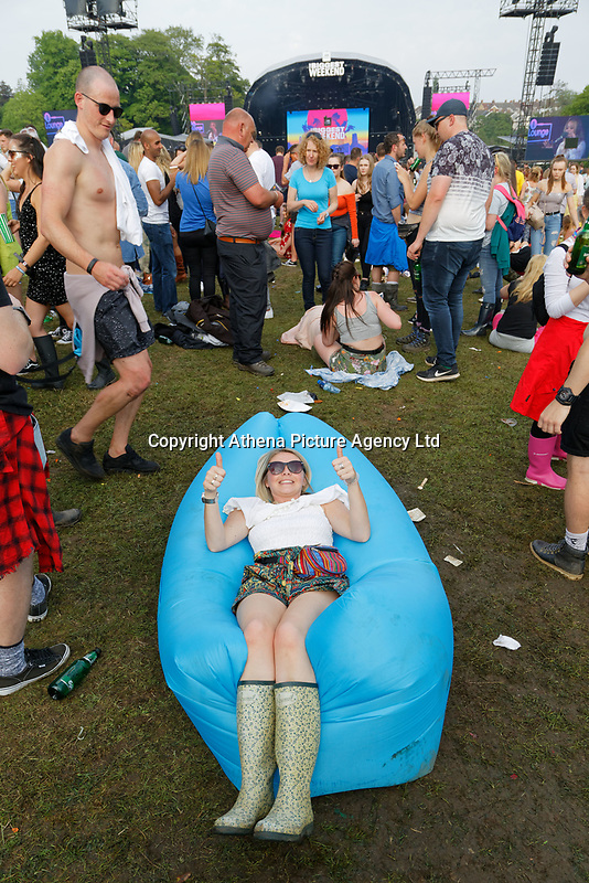 Pictured: A woman lies on an inflatable. Saturday 26 May 2018<br /> Re: BBC Radio 1 Biggest Weekend at Singleton Park in Swansea, Wales, UK.