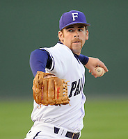 Pitcher Daniel Stallsmith (14) of the Furman Paladins in a game against the Georgia Bulldogs on Wednesday, March 2, 2011, at Fluor Field in Greenville, S.C.  Photo by Tom Priddy / Four Seam Images