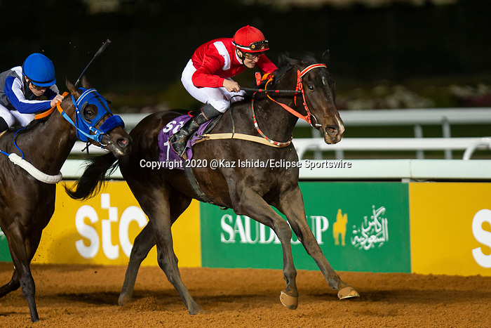RIYADH,SAUDI ARABIA-FEB 28: Sabeq'hom, ridden by Sibylle Vogt,wins the 4th leg of International Jockeys Challenge at King Abdulaziz Racetrack on February 28,2020 in Riyadh,Saudi Arabia. Kaz Ishida/Eclipse Sportswire/CSM