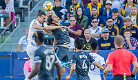 CARSON, CA - SEPTEMBER 29: Zlatan Ibrahimovic #9 of the Los Angeles Galaxy and Jasser Khmiri #20 of the Vancouver Whitecaps battle in the air for a ball during a game between Vancouver Whitecaps and Los Angeles Galaxy at Dignity Health Sports Park on September 29, 2019 in Carson, California.