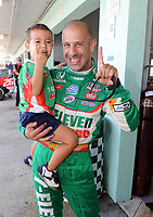 HOMESTEAD, FL - OCTOBER 01: Tony Kanaan of Brazil, driver of the #11 Team z-Eleven Dallara Honda talks with his son Leonardo during qualifying for the IZOD IndyCar Series Cafes do Brasil Indy 300 at Homestead-Miami Speedway on October 1, 2010 in Homestead, Florida<br /> <br /> <br /> People:  Tony Kanaan_Leonardo Kanaan