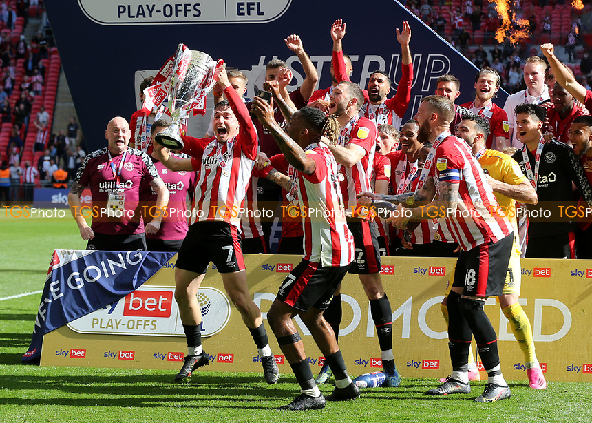 Sergio Canos holds the Championship Trophy aloft as Brentford celebrate promotion to the Premier League during Brentford vs Swansea City, Sky Bet EFL Championship Play-Off Final Football at Wembley Stadium on 29th May 2021