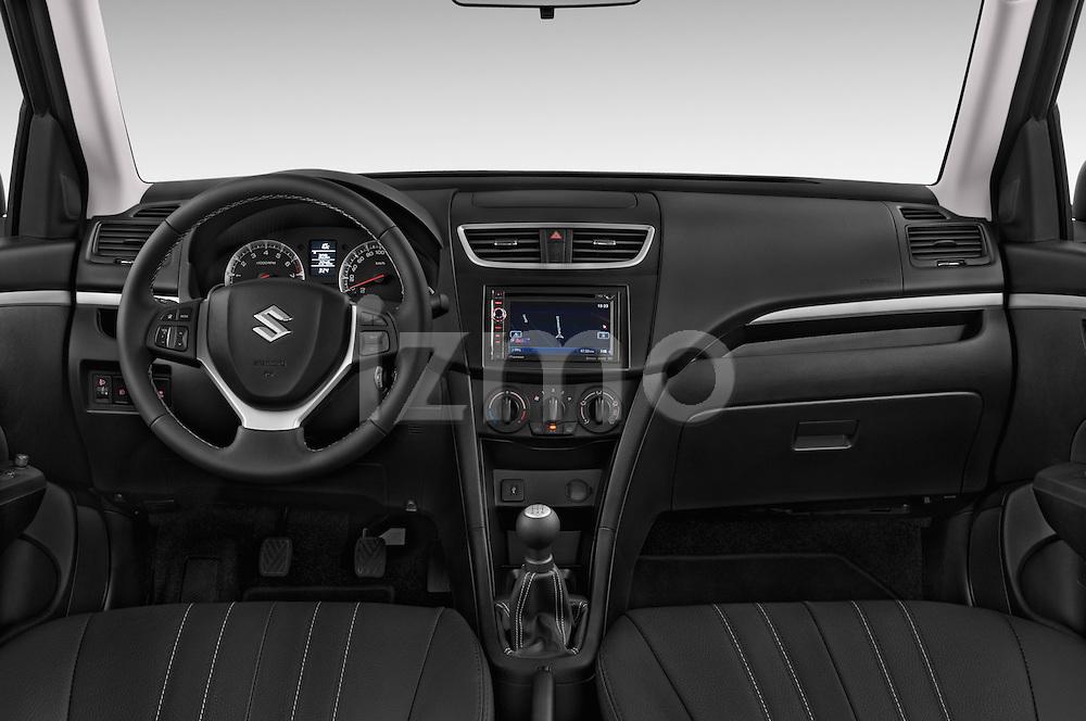 Stock photo of straight dashboard view of a 2013 Suzuki SWIFT Grand Luxe @ttraction 5 Door Hatchback 2WD Dashboard