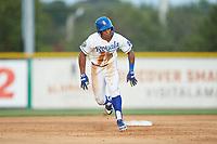 Kevon Jackson (11) of the Burlington Royals hustles towards third base against the Danville Braves at Burlington Athletic Stadium on July 13, 2019 in Burlington, North Carolina. The Royals defeated the Braves 5-2. (Brian Westerholt/Four Seam Images)