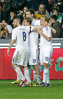 Finland's players celebrate after scoring a goal during international match of the qualifiers for the FIFA World Cup Brazil 2014.March 22,2013.(ALTERPHOTOS/Victor Blanco)