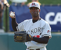 Outfielder Andrew McCutchen (1) of the Hickory Crawdads, the Pittsburgh Pirates affiliate of the Class A South Atlantic League, warms up prior to a game against the Greenville Drive on May 13, 2006, at Fluor Field at the West End in Greenville, South Carolina. (Tom Priddy/Four Seam Images)