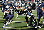 Nevada runningback Lampford Mark (29) runs past Idaho defender Korey Toomer (16) during the second quarter of an NCAA football game in Reno, Nev., on Saturday, Dec. 3, 2011. .Photo by Cathleen Allison