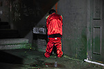 © Joel Goodman - 07973 332324 . 27/12/2015 . Wigan , UK . A man dressed as one of the Beatles from Sergeant Pepper urinates in an alleyway . Revellers in Wigan enjoy Boxing Day drinks and clubbing in Wigan Wallgate . In recent years a tradition has been established in which put on fancy dress for a Boxing Day night out . Photo credit : Joel Goodman
