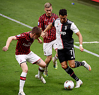 Andrea Conti, Alexis Saelemaekers of AC Milan and Cristiano Ronaldo of Juventus compete for the ball during the Serie A football match between AC Milan and Juventus FC at stadio San Siro in Milan ( Italy ), July 7th, 2020. Play resumes behind closed doors following the outbreak of the coronavirus disease. <br /> Photo Federico Tardito / Insidefoto