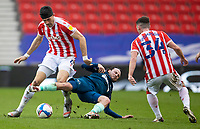 20th March 2021; Bet365 Stadium, Stoke, Staffordshire, England; English Football League Championship Football, Stoke City versus Derby County; Patrick Roberts of Derby County tackles Danny Batth of Stoke City