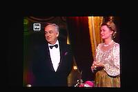 """---- NO TABLOIDS, NO WEB -- EXCLUSIF - Le Prince Rainier III de Monaco et son épouse la Princesse Grace sur l'écran lors de la Ciné-conférence avec la projection du film """"L'invention de Monte Carlo"""", 150 ans d'histoire en images, proposée par les Archives audiovisuelles de Monaco et les Archives du Palais Princier de Monaco, le 22 juin 2016 à l'Opéra Garnier de Monaco. Ce film documentaire commenté en direct sur la scène de l'Opéra relate toute l'histoire de ce quartier de la Principauté : """"Monte Carlo"""" rendu célébre dès le début du XXeme siécle par son Casino puis par les nombreuses manifestations de prestiges qui y ont été organisées autant culturelles, comme les ballets ou les concerts de musique classique, ou que le Festival de Télévision, mais aussi sportives comme les départs des Rallyes de Monte Carlo. A travers ce quartier mythique de la Principauté, le spectateur est plongé dans l'histoire de Monaco et de son développement touristique et économique, de la création de la Société des Bains de Mer (SBM), au face à face entre le Prince Rainier III et Onassis, sans oublier les nombreux films tournés à Monte Carlo. # LE PRINCE ALBERT DE MONACO ET LA PRINCESSE CAROLINE A UNE CINE-CONFERENCE A L'OPERA GARNIER DE MONACO"""