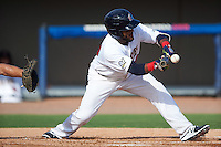 Brevard County Manatees shortstop Wendell Rijo (23) lays down a bunt during a game against the Daytona Tortugas on August 14, 2016 at Space Coast Stadium in Viera, Florida.  Daytona defeated Brevard County 9-3.  (Mike Janes/Four Seam Images)