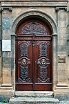 Carved wooden door serving as the entrance to the Hotel d'Estienne de Saint-Jean, a townhouse built about 1671 now serving as the Musée du Vieil Aix. The door itself dates from the 18th century.