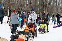 Alan Eischens and team run past spectators on the bike/ski trail near University Lake with an Iditarider in the basket and a handler during the Anchorage, Alaska ceremonial start on Saturday, March 7 during the 2020 Iditarod race. Photo © 2020 by Ed Bennett/Bennett Images LLC