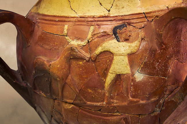 Hüseyindede vases, Old Hittite Polychrome Relief vessel, third freeze down depicting a man leading a bull, 16th century BC. Huseyindede . Çorum Archaeological Museum, Corum, Turkey. Against a warm art bacground.