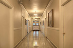 Long hallway circa 1927, meeting in progress sign.  Dating to 1927, the Masonic Retirement Center, locally known as the Masonic Home, in Des Moines, Washington is now an elegant event center available for rental.  In the historic Zenith neighborhood of the city of Des Moines. Please conact douglasorton@comcast.net regarding licensing of this image.