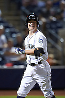 Peoria Javelinas Tyler O'Neill (11), of the Seattle Mariners organization, smiles while walking back to the dugout after hitting a home run during a game against the Glendale Desert Dogs on October 18, 2016 at Peoria Stadium in Peoria, Arizona.  Peoria defeated Glendale 6-3.  (Mike Janes/Four Seam Images)