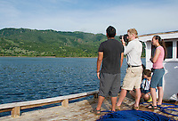 British herpetologist Mark O'Shea stands with American students Jester Ceballos, Eric Leatham, and Caitlin Sanchez on the deck of a small boat leaving the dock at Beloi, Atauro Island, bound for Dili, Timor-Leste (East Timor)