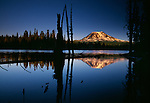 Mount Adams' northern slopes at sunset, reflected in Horseshoe Lake, Washington.